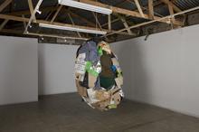 Beneath Giant Ficus Trees, 2009 Garbage, cardboard, plastic, nylon and fabric, 150